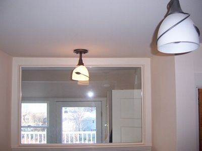South Portland Whole House Renovation glassed in laundry room