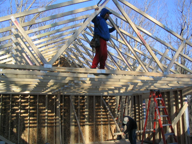 Matt walks the trusses while helping Habitat in Cumberland